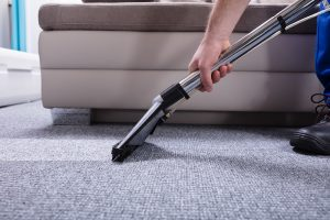 Janitor-Cleaning-Carpet-235838623.jpg