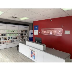 Ubreakifix Dallas Tx Inside Store for iPhone Repair Red Wall and Rack of Phone Accessories.jpg