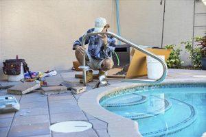 640-22490443-installing-safety-pool-hand.jpg